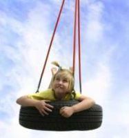 Girl on a tyre swing