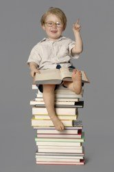 Boy sitting on books